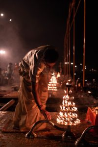 Lighting diyas on Diwali