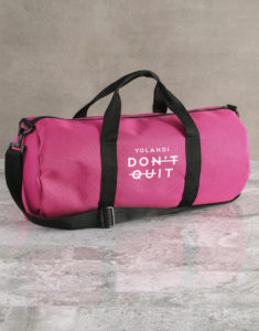 "A pink gym duffel bag personalised with the name of the receiver to accompany the phrase ""Don't Quit/Do It."""